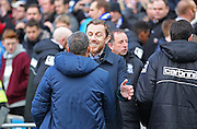Brighton Manager Chris Hughton meets with Birmingham City's Manager Gary Rowett during the Sky Bet Championship match between Brighton and Hove Albion and Birmingham City at the American Express Community Stadium, Brighton and Hove, England on 21 February 2015. Photo by Phil Duncan.
