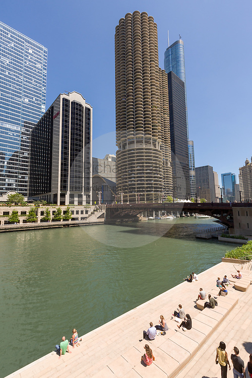 People relax and view the skyline from the Riverwalk on the Chicago River in Chicago, Illinois, USA