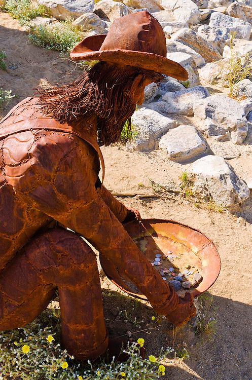 Metal sculpture of a gold miner by Ricardo Breceda at Galleta Meadows Estate, Borrego Springs, California USA