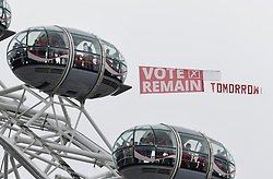 © Licensed to London News Pictures. 22/06/2016. London, UK. A light aircraft tows a Vote Remain banner over the London Eye at Westminster on the last day of campaigning in the EU referendum. Photo credit: Peter Macdiarmid/LNP
