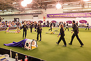 New York, NY - 8 February 2014. Dog handlers walking their ways through the agility course prior to the start of the trials. In the foreground is a tunnel  which is closed at the far end.