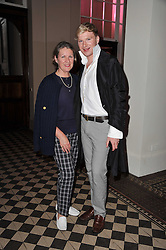 HENRY CONWAY and his mother COLETTE CONWAY at a fashion show by Catherine Walker & Co in support of The Haven held at One Mayfair, North Audley Street, London on 18th May 2011.
