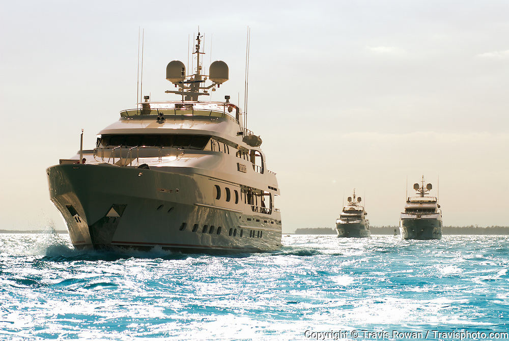Three large luxury yachts cruising in formation in the Port of Miami, Florida. M/Y Barchetta, M/Y Mystic and M/Y Primadonna were among the newest from American shipyard Christensen in 2007.
