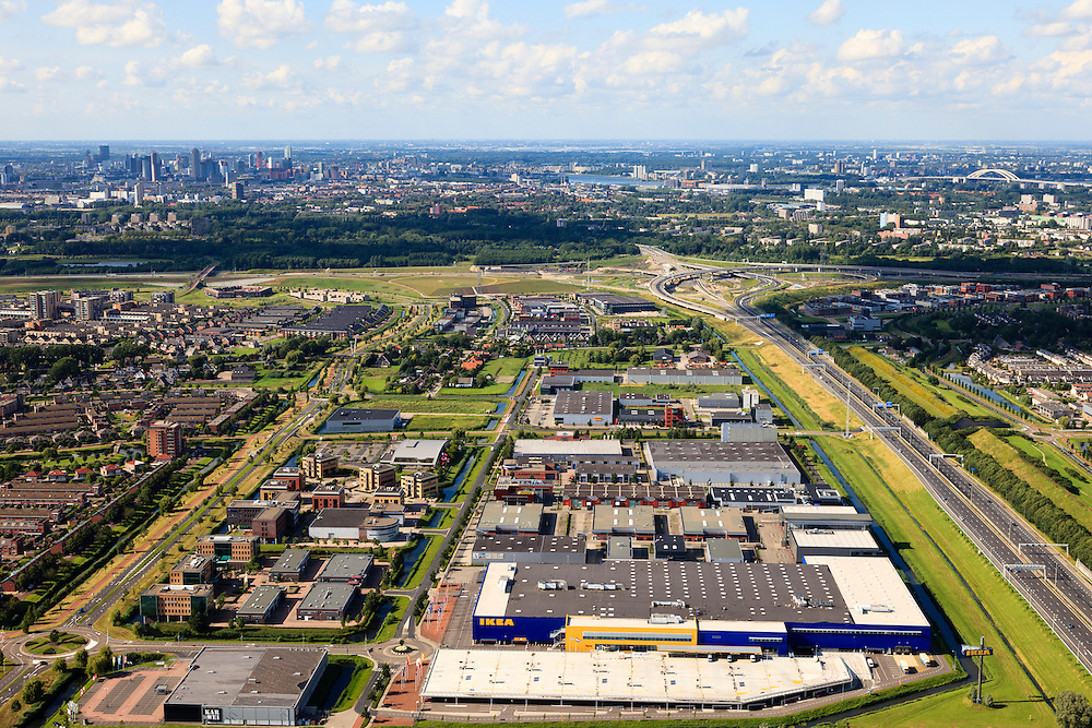 Nederland, Zuid-Holland, Barendrecht, 15-07-2012; Carnisselande Rechts de A29, links Vaanpark met IKEA. Skyline Rotterdam en Van Brienenoordbrug aan de horizon..Business park with the IKEA company next to roadway A29. Skyline Rotterdam in the back. luchtfoto (toeslag), aerial photo (additional fee required).foto/photo Siebe Swart