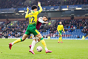 Burnley midfielder Aaron Lennon (25) tackled by Norwich City defender Jamal Lewis (12) during the The FA Cup match between Burnley and Norwich City at Turf Moor, Burnley, England on 25 January 2020.