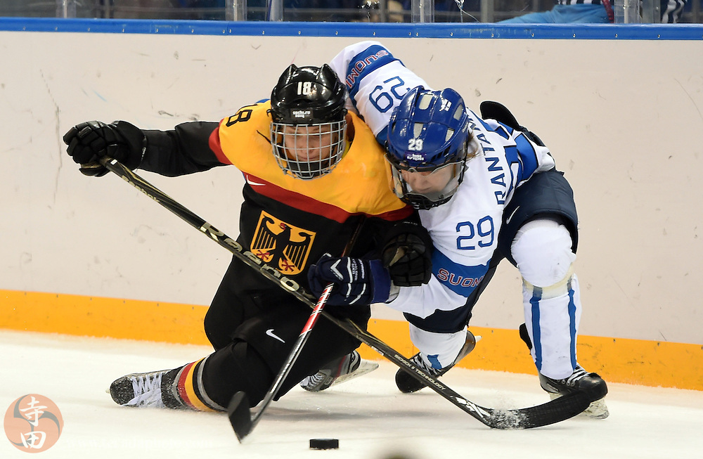 Feb 16, 2014; Sochi, RUSSIA; Finland forward Karoliina Rantamaki (29) battles for the puck with Germany defenseman Susanne Fellner (18) in the women's ice hockey classifications round during the Sochi 2014 Olympic Winter Games at Shayba Arena.