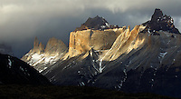 Gorgeous spotlight illuminates the  majestic peaks of the Cuernos del Paine in Chile's Torres del Paine National Park. It is the constant interplay of ever changing cloud formations and light that make photography so special in Patagonia!