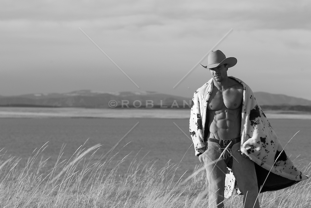 cowboy, body, abs, blanket, ranch, cowboy hat, one hot cowboy, one of the sexiest cowboys in the USA, USA, no shirt, chaps, black and white photography, cowboy hat, muscle, muscular cowboy, shadows, open space, summer, ranch, lake, by a lake, smooth body, smooth cowboy body, thirty something years old, one sexy cowboy