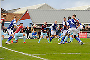 The ball is headed in to the area for Richard Bennett (9) of Barrow to score the equalising goal to make the score 2-2 during the The FA Cup match between Taunton Town and Barrow at the Viridor Stadium, Taunton, United Kingdom on 6 November 2016. Photo by Graham Hunt.