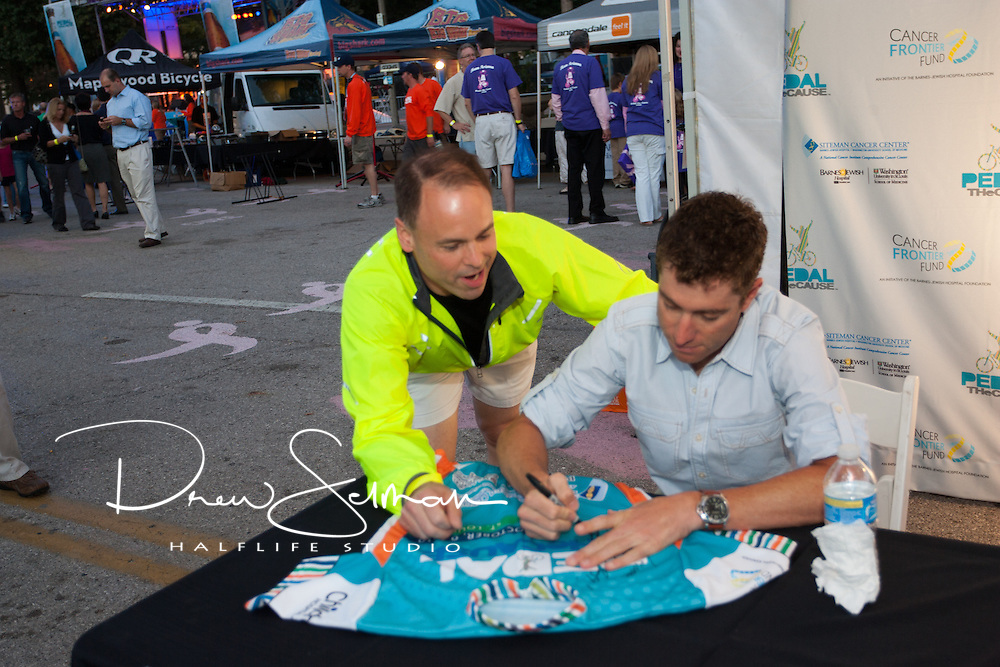8-OCT-2010 -- ST LOUIS - Pro-cyclist Christian Vande Velde signs autographs and greats fans at the inaugural Pedal the Cause cycling event.  Vande Velde rode on October 9th with the rest of the field.  Vande Velde currently rides with Team Garmin-Transitions and is the 2008 winner of the Tour of Missouri.   He was sidelined early this year when he crashed at the 2010 Giro d'Italia on the 3rd stage with a suspected clavicle break.  He also withdrew after completing the second stage of the 2010 Tour de France with two broken ribs he sustained in a crash caused by oil spilled from a fallen motorcycle in the Stockeu pass descent. Pedal the Cause is an annual cycling event that seeks to provide and direct net funding for cancer research, cancer discovery grants and clinical translational care on best ideas not currently eligible for federal funds.  With 100% of donations remaining in St. Louis, the event was started by Bill Koman, a St Louis business man and himself a cancer survivor.