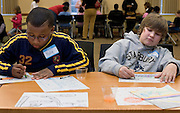 "Kaliq Carr (left) and Eben Tobar draw cars together during the ""It Takes a Village"" program at O.U.'s Multicultural Center on Monday, 1/15/07. The program's goal was to teach tolerance through interactive activities for children."