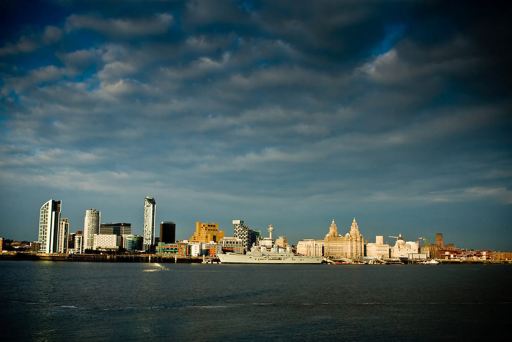 Docked against the Liverpool skyline on a beautiful Sunday evening..The Ferry is just so tiny compared to everything.  The Liverpool.pilots are orange dots.