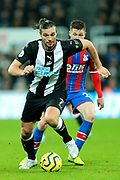 Andy Carroll (#7) of Newcastle United on the ball during the Premier League match between Newcastle United and Crystal Palace at St. James's Park, Newcastle, England on 21 December 2019.