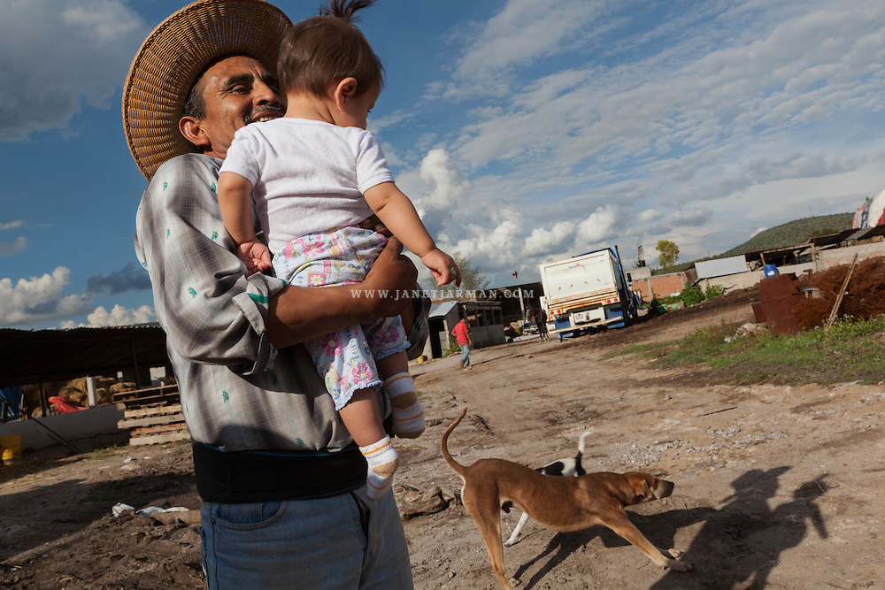 Valenciano Cortéz Villa Hernán shares a moment with his granddaughter, on his farm in El Salto, near Tula, in Hidalgo State. He yearns for her to be able to enjoy a clean environment, as he did as a child, before black waters began to contaminate his region known as the Mezquital Valley.The cumulative effects of many decades of the use of wastewater sewage to irrigate the Valley has created conflict between farmers who are dependent on this nutrient rich source of water and inhabitants of the valley's towns whose health is negatively affected by the contamination.