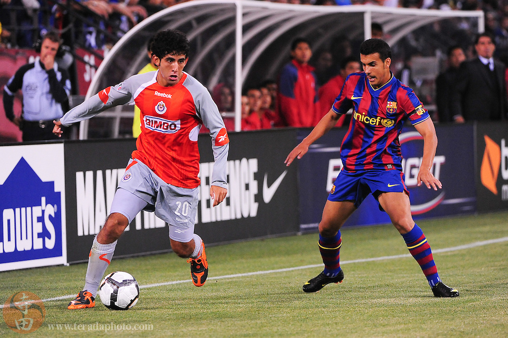 August 8, 2009; San Francisco, CA, USA; Chivas de Guadalajara defender Edgar Mejia (20) controls the ball against FC Barcelona defender Pedro Rodriguez (27, right) during the first half in the Night of Champions international friendly contest at Candlestick Park.