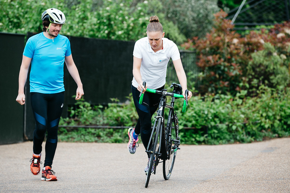 Journalist, Oliver Pickup, tests his cycling techniques after tutoring from British professional triathlete Jodie Stimpson. 6th May 2015, London. Photographed by Greg Funnell for the Financial Times.