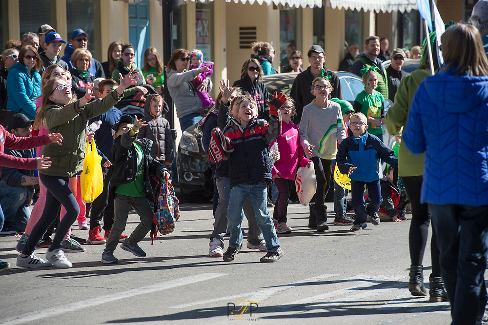 Kids scramble to cath candy thrown during the St. Patrick's Day parade held Tuesday on Main Street in Fond du Lac. Tuesday, March 17, 2018, Patrick Flood Photography