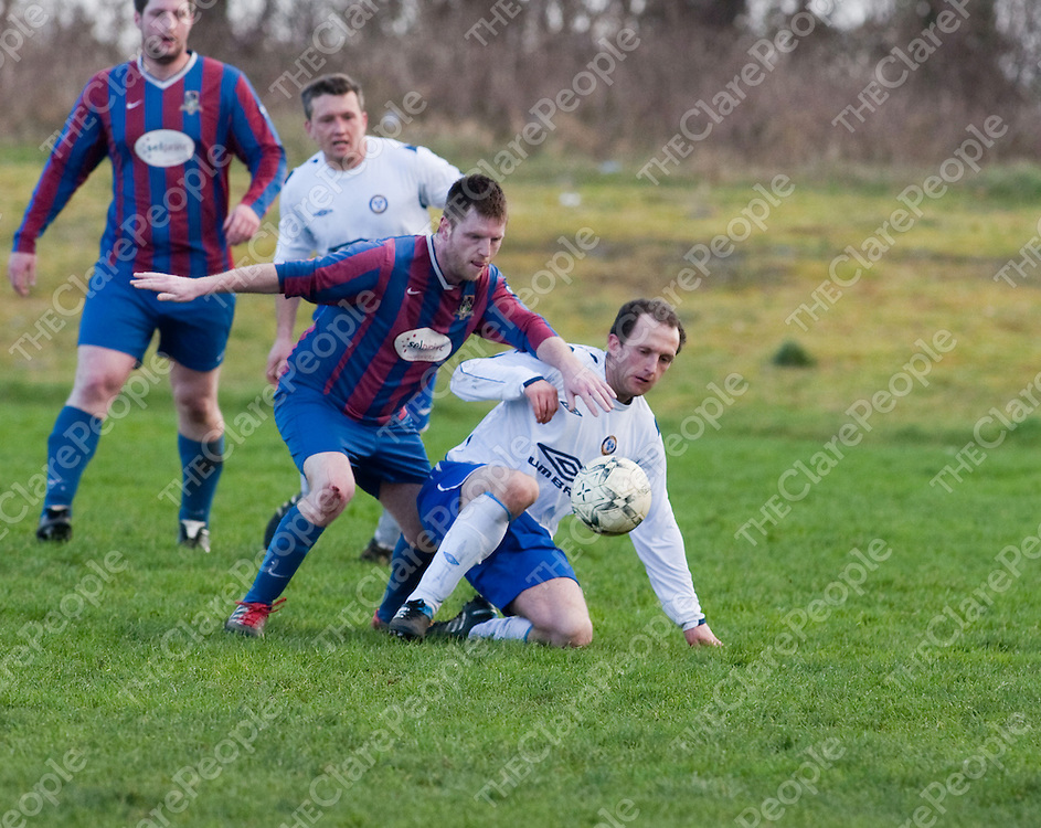 Shannon's Jason Regan &amp; Ennis Town's Gary Walsh in action during their Game played in Ennis.<br /> Picture Credit  Brian Gavin Press 22