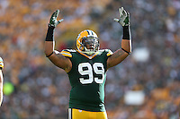 Green Bay Packers defensive end Jerel Worthy (99) waves his hands to the crowd before the snap against the San Francisco 49ers during an NFL football game in Green Bay, Wisconsin Saturday, Sept. 9, 2012. (AP Photo/Tom Hauck)