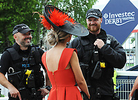 Flat Horse Racing - 2019 Investec Derby Festival - Friday, Day One (Ladies Day)<br /> <br /> Ladies talk to the Police security  at Epsom Racecourse.<br /> <br /> COLORSPORT/ANDREW COWIE