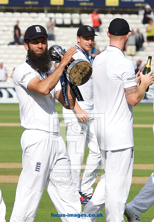 Moeen Ali of England with the trophy after winning the Ashes test series during the 5th Investec Ashes Test match at the Kia Oval, London<br /> Picture by Alan Stanford/Focus Images Ltd +44 7915 056117<br /> 23/08/2015