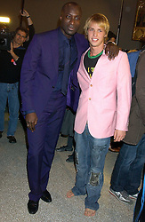 Left to right, OZWALD BOATENG and SAM BRANSON at a fashion show and after party to celebrate the 20th Anniversay of fashion designer Ozwald Boateng held at the Victoria & Albert Museum, London on 25th November 2005.<br />