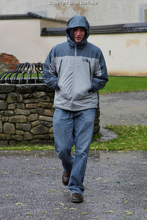 Joel walks in the rain in Bytca, Slovakia on Sunday July 3rd 2011. (Photo by Brian Garfinkel)