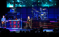 "Adam Levine, PJ Morton (keys), Matt Flynn (drums), Michael Madden (Bass) of Maroon 5 perform at the Hollywood Bowl in support of ""Hands All Over"" on July 25, 2011 in Los Angeles, California."