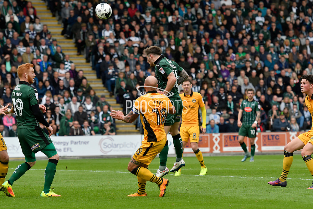 Matthew Kennedy (16) of Plymouth Argyle scores a headed goal to give a 1-0 lead to the home team during the EFL Sky Bet League 2 match between Plymouth Argyle and Newport County at Home Park, Plymouth, England on 17 April 2017. Photo by Graham Hunt.