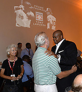 COOPERSTOWN, NY - JULY 26:  2014 Hall of Fame inductee Frank Thomas reunites with former White Sox manager Jeff Torborg as Jeff's wife Suzie looks on during a private reception held at Templeton Hall in Cooperstown, New York on July 26 2014.