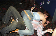 A girl lying on top of a man on the floor of a club, Roar, Evolution, Cardiff, Wales, 2001