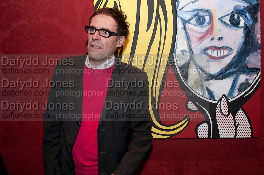 DEXTER DALWOOD IN FRONT OF HIS PORTRAIT OF CLAUDIA SCHIFFER, , Capturing Claudia. Interpretations of Claudia Schiffer by leading contemporary artists for Harpers Bazaar magazine. Colnaghis Gallery. Old Bond st. and afterwards at Locanda Locatelli's restaurant. Portman sq. London. 2 November 2009.