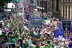 © Licensed to London News Pictures. 10/06/2018. London, UK. Thousands of women march through central London wearing the colours of the Sufragette movement. PROCESSIONS, a mass artwork celebrating 100 years of women getting the vote, is also taking place in Belfast, Cardiff and Edinburgh. Photo credit: Peter Macdiarmid/LNP