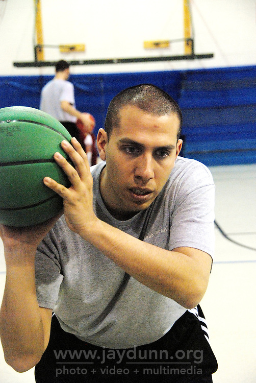 "USA, Chicago, IL, December 16, 2009.  Rob Castaneda demonstrates technique. Founded ten years ago by Rob and Amy Castaneda, ""Beyond the Ball"" is a non-profit organization dedicated to giving kids and parents a healthy place to play together, whether it be in an after-school program or during an summer series of playground days, like last year's wildly successful ""Project Play."" The predominantly working-class neighborhoods of Little Village and North Lawndale have no park, and little public space for families that is safe from the gang violence endemic to large US cities. Beyond the Ball's approach is personal, and takes a long-term view - both Rob and Amy are neighborhood residents, and have experienced first-hand the anger of gang members. The group arranges for school facilities to be open late, such as this gym at Josefa Ortiz de Dominguez Elementary, and welcomes student volunteers who also get credit from Chicago Public Schools for doing community service. Many of the teenagers working with ""Beyond the Ball"" are comfortable as mentors, because they've been in the program before. It is easy to see the pride they take in teaching and taking responsibility for the younger kids, and how such a positive approach to neighborhood building can work. Photo for Hoy by Jay Dunn."