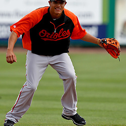 March 25, 2012; Clearwater, FL, USA; Baltimore Orioles shortstop Manny Machado field during batting practice before a spring training game against the Philadelphia Phillies at Bright House Networks Field. Mandatory Credit: Derick E. Hingle-US PRESSWIRE