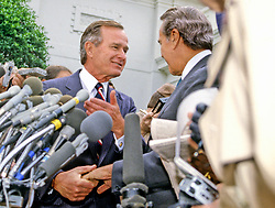 United States President-elect George H.W. Bush and U.S. Senate Republican Leader Bob Dole (Republican of Kansas) meet reporters at the White House in Washington, D.C. following their luncheon meeting on November 28, 1988.<br /> Credit: Ron Sachs / CNP