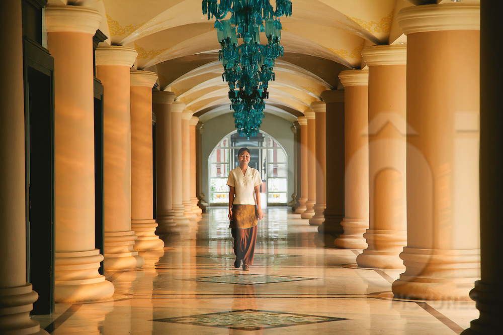 An hostess walks in a corridor of Dhara Dhevi Resort in Chiang Mai, Thailand, Southeast Asia