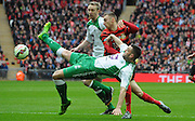 Louis Moult charging through the North Ferriby defence during the FA Carlsberg Trophy Final match between North Ferriby United and Wrexham FC at Eon Visual Media Stadium, North Ferriby, United Kingdom on 29 March 2015. Photo by Michael Hulf.