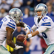 Oct 25, 2015; East Rutherford, NJ, USA; Dallas Cowboys quarterback Matt Cassel (16)hands ball off to Dallas Cowboys running back Darren McFadden (20) in the 2nd quarter at MetLife Stadium. Mandatory Credit: William Hauser-USA TODAY Sports
