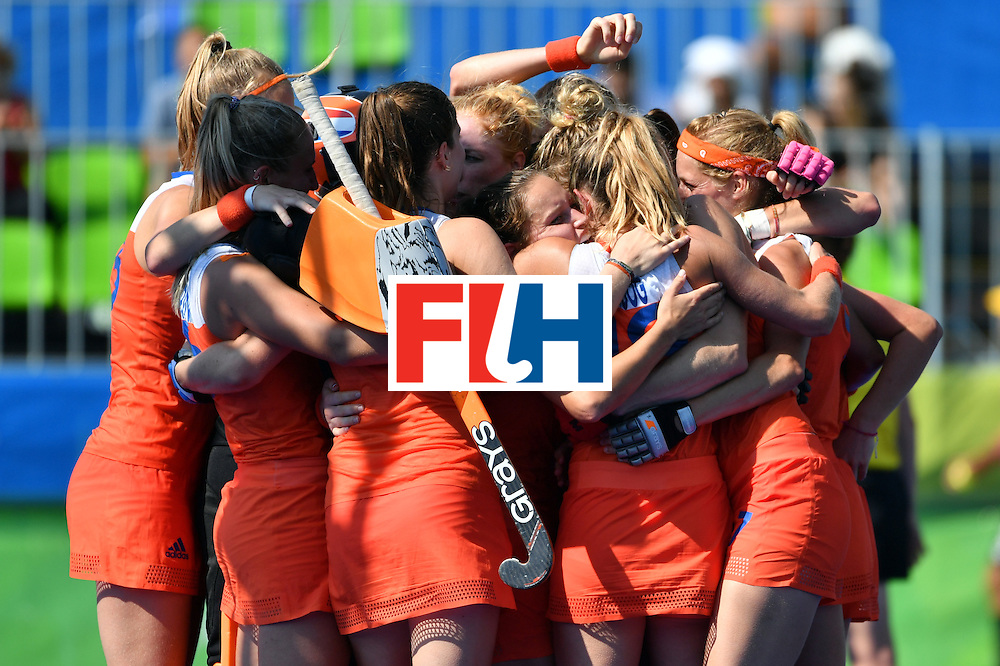 TOPSHOT - Netherlands' players celebrate after the penalty shoot-out at the end of the the women's semifinal field hockey Netherlands vs Germany match of the Rio 2016 Olympics Games at the Olympic Hockey Centre in Rio de Janeiro on August 17, 2016. / AFP / Pascal GUYOT        (Photo credit should read PASCAL GUYOT/AFP/Getty Images)