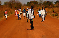 18 year old, kamilo Odayi,  leads a group of members of the Bari tribe to the Kurik Center polling station to participate in the South Sudan referendum for self determination. PHOTO: MIGUEL JUAREZ LUGO).