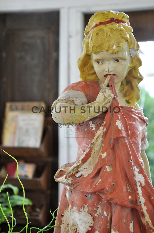 Architectural Salvage Shed: Detail of vintage garden statue