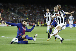 (L-R) Gerard Pique of FC Barcelona, Nelson Semedo of FC Barcelona, Gonzalo Higuain of Juventus FC during the UEFA Champions League group D match between FC Barcelona and Juventus FC  on September 12, 2017  at the Camp Nou stadium in Barcelona, Spain.