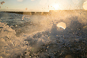 Sunset and crashing waves at Utsumi beach resort.