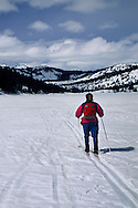 Cross country skiing on a frozen Echo Lake in winter, near Lake Tahoe, California