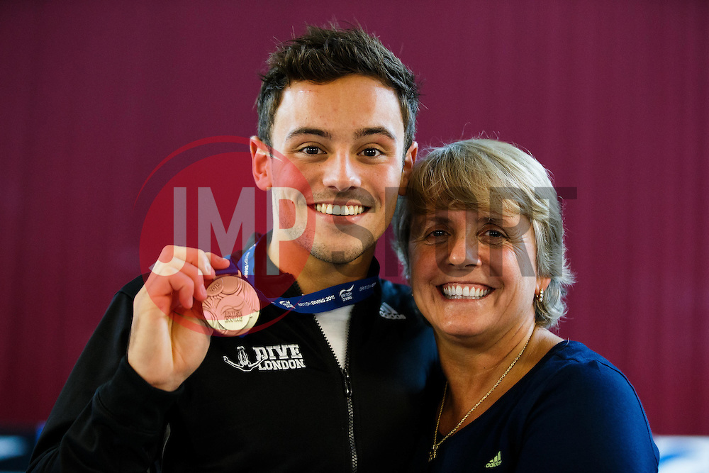 Tom Daley of Dive London Aquatic Centre poses with coach Jane Figueiredo of Dive London Aquatic Centre after winning the Mens 10m Platform Final - Photo mandatory by-line: Rogan Thomson/JMP - 07966 386802 - 22/02/2015 - SPORT - DIVING - Plymouth Life Centre, England - Day 3 - British Gas Diving Championships 2015.