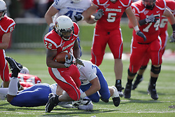 17 October 2009:  Geno Blow gets stopped by Alex Sewall after a yardage gain.The Indiana State Sycamores tumble to the Illinois State Redbirds 38-21 at Hancock Stadium on campus of Illinois State University in Normal Illinois