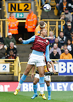 Photo: Steve Bond/Richard Lane Photography. Wolverhampton Wanderers v Aston Villa. Barclays Premiership 2009/10. 24/10/2009. John Carew is beaten by Jody Craddock