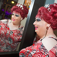 Female impersonator Wayne Chamberlain, the reigning Miss Gay Portland XLI, checks her personna in the mirror at CC Slaughters Nightclub and Lounge in Portland.12:29am