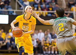 Jan 30, 2016; Morgantown, WV, USA; West Virginia Mountaineers guard Katrina Pardee (22) holds the ball while guarded by Baylor Bears guard Niya Johnson (2) during the first quarter at WVU Coliseum. Mandatory Credit: Ben Queen-USA TODAY Sports